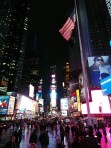 I liked the American flag flying above the crowd in Times Square.